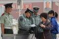 Security checks have been tightened on Beijing's public transport, including the entrances to subway stations, since last month's Asia-Pacific Economic Cooperation summit in the capital. File Photo: AFP