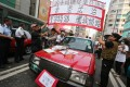 Taxi drivers protest against Occupy protesters in Mong Kok on October 22, 2014. Photo: Felix Wong