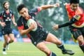Hong Kong's Hugo Chui Ho-ching scores a try during the hosts' 34-0 victory over China early on the first day of Asia's U20 Sevens Series finale in Hong Kong. Photos: Asian Rugby Football Union