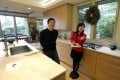 Janie Lee shows a property to her client Wei Hongbin. Photo: AP