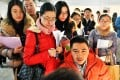 Graduates attend a job fair in Beijing. Internet finance is now seen as a desirable career by well-educated young Chinese. Photo: Xinhua