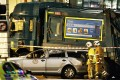 Emergency workers survey the damage caused by a garbage truck that tore through crowds in Glasgow on Monday. Photo: EPA