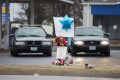 A memorial for Antonio Martin, an armed 18-year old black teen who was fatally shot by police in Berkeley, Missouri, December 24, 2014. Photo: Reuters