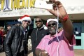 """Movie goers Carlos Royal, right, Ryan Bergstrom, left, and Khai Ky-Yeith pose for a selfie as they attend the Christmas Day screening of """"The Interview"""" in the Van Nuys section of Los Angeles, California December 25, 2014. Photo: Reuters"""