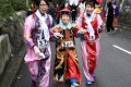 Runners dressed in traditional Chinese attire compete in Friday's run at Wan Chai Gap. Photo: Richard Castka