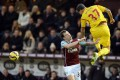 Liverpool defender Martin Skrtel heads the ball under pressure from Burnley striker Ashley Barnes. Photo: AFP