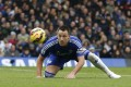 Chelsea's John Terry heads the ball back to his goalkeeper while on defensive duties against West Ham United at Stamford Bridge on Boxing Day. Chelsea maintained their 100 per cent home record in the league this season with a 2-0 win. Photo: AFP