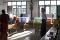 Voters cast their ballots in Yangon municipal elections on Saturday. Photo: AFP
