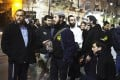 Benzion Gopshtein (left), leader of the far-right Israeli group Lehava, with fellow activists in Jerusalem on Thursday. Photo: Reuters