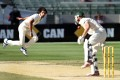 Indian bowler Ishant Sharma hits Shaun Marsh with a short ball during the fourth day of the third test in Melbourne. Photo: AFP