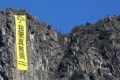 Another yellow banner is unfurled atop the famous Lion Rock. Like the one hoisted there in October, it carries the slogan 'I want genuine universal suffrage'. Photo: Nora Tam