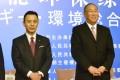 Japan's Yosuke Takagi (left) and China's Xie Zhenhua at the eighth Japan-China Energy Conservation Forum in Beijing. Photo: Kyodo