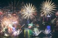 Fireworks over Victoria Harbour to mark the start of 2015 in Hong Kong. Photo: Nora Tam