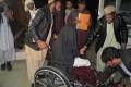 An injured Afghan woman arrives at hospital. Photo: AFP