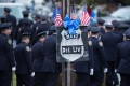 Police from the 84th precinct arrive at the wake for Officer Wenjian Liu at a funeral home in Brooklyn. Photo: AFP