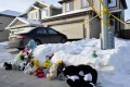 A makeshift memorial at the home where seven persons were found dead in Edmonton. Photo: Reuters