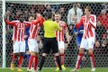 Stoke City players appeal to referee Michael Oliver for handball against United defender Chris Smalling. Photos: AFP