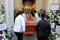 Ronald Li's coffin is carried into St John's Cathedral. Photo: May Tse