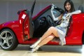 Scantily clad models are a staple at most car shows. Photo: AP