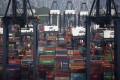 Shipping containers sit stacked between container cranes at Kwai Tsing Container Port in Hong Kong. Photo: Bloomberg