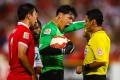 China's Wang Dalei shouts at referee Alireza Faghani in their match against Saudi Arabia. Photo: AFP