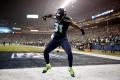 Seattle Seahawks defender Kam Chancellor celebrates after scoring a 90-yard touchdown off an interception at CenturyLink Field. Photo: AFP