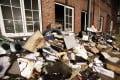 Burnt and damaged files are seen in the courtyard of German regional newspaper Hamburger Morgenpost in Hamburg. Photo: EPA