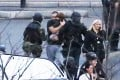Members of the French police special forces evacuate hostages including a child (centre) after launching the assault at a kosher grocery store in Porte de Vincennes, eastern Paris. Photo: AFP
