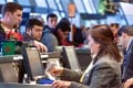 Travellers check in with agents at United Airlines. The airline saw thieves book trips or make mileage transactions on up to three dozen accounts in a recent security breach. Photo: AFP