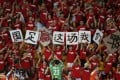 Goalkeeper Wang Dalei acknowledges supporters as they celebrate China's win over Uzbekistan in their Asian Cup group B match in Brisbane yesterday. Photo: Reuters