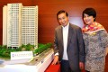 Lee Shau-kee and Angela Leong On-kei, the chairman of Po Leung Kuk, with a model of the hostel. Photo: Nora Tam