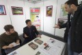 North Korea's sparse stall at the travel fair in Switzerland. Photo: EPA