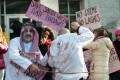 Protesters simulate the flogging in front of the US Saudi embassy in Washington on Thursday. Photo: AFP