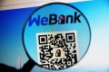 WeBank, the mainland's first internet bank controlled by Tencent Holdings, was launched in Shenzhen yesterday. Photo: Imaginechina