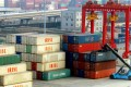 Containers are stacked up in a port in China's Jiangsu province. The country still has a ways to go before it becomes the world's No. 1 economy. Photo: AFP