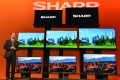 Sharp Corp of Japan unveils its new high-definition TV as the company in Tokyo issued a profit warning while its shares slid to a 2-year low. Photo: Kyodo