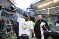 Seattle Seahawks quarterback Russell Wilson hefts the George Halas Trophy after defeating the Green Bay Packers. Photo: TNS