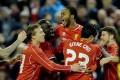 Raheem Sterling celebrates with Liverpool teammates. Photo: EPA