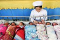 A nurse attends to newborns in a hospital in China. The country's strict birth control policy in a culture that favours boys has resulted in a skewed gender ratio. Photo: Xinhua