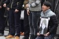 A man holds a portrait of a Shanghai stampede victim. Photo: AP