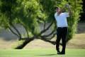 Michael Putnam hits into 18. Photo: AFP