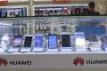 Huawei smartphone products are displayed for sale with other brands at a shopping mall in Beijing, China. Photo: EPA