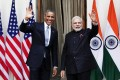 U.S. President Barack Obama and India's Prime Minister Narendra Modi (right) wave during a photo opportunity ahead of their meeting at Hyderabad House in New Delhi. Photo: Reuters