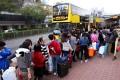 Cross-border shoppers form a lengthy queue at the Tuen Mun bus terminal. Photo: SCMP Pictures