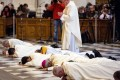 The archbishop of Granada, Francisco Javier Martinez (3rd from right), prostrates himself on the floor, along with other priests in a mass two months ago, in a gesture of apology to victims of abuse. Photo: AFP