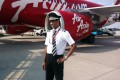 Co-pilot Remi Plesel in front of an AirAsia plane. Photo: AFP