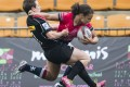 Hong Kong's Natasha Olson-Thorne pushes away from the Canadian defence during last year's Hong Kong Women's Rugby Sevens. Photos: HKRFU