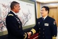 Sun Jianguo, Deputy Chief of General Staff of the PLA, right, greets Vincent Brooks, Commanding General of the US Army Pacific, in Beijing on January 15. Photo: AFP