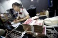 While many are calling for the yuan's trading band to be widened, the PBOC is showing little sign of moving in that direction. Photo: Reuters