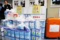 Customs officials show milk powder confiscated in Lo Wu. Photo: Felix Wong